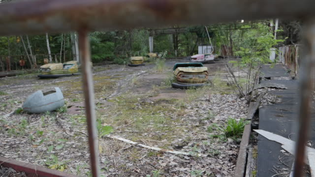 exterior shots of an abandoned dodgem car track overgrown with weeds in the city of pripyat, abandoned after the chernobyl disaster, on 10 june 2019... - bumper car stock videos & royalty-free footage