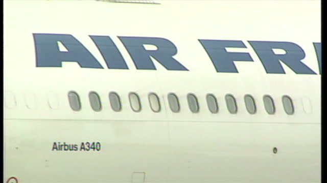 exterior shots of an air france airbus a340 plane taxiing on the airfield and close up shots of the engines tail tyres and an air france plane taking... - charles de gaulle stock videos & royalty-free footage
