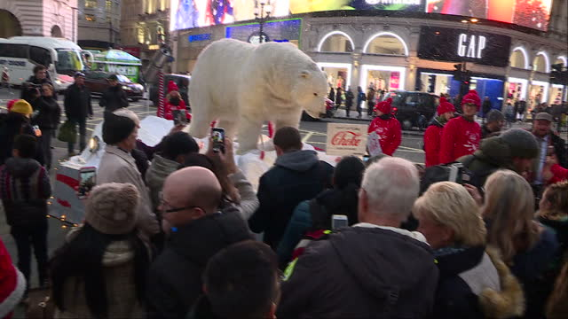 exterior shots of an animatronic polar bear on an imitation ice flow studded with plastic bottles at the centre of a greenpeace demonstration in... - studded stock videos and b-roll footage