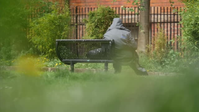 exterior shots of an anonymous homeless man sitting on a park bench on may 12 2016 in london england - northwest england stock videos and b-roll footage