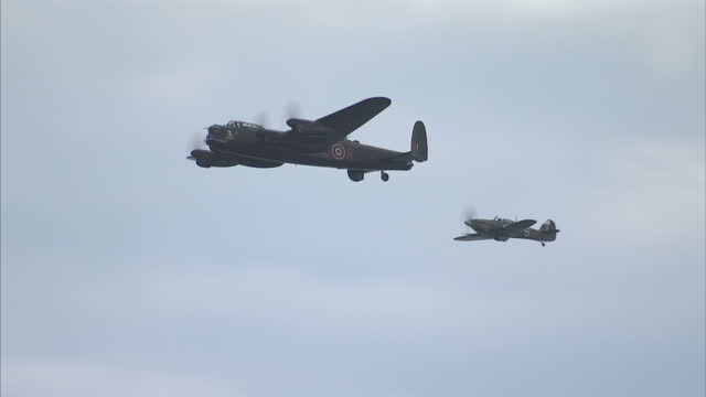 exterior shots of an avro lancaster and hawker hurricane in a flypast at the sunderland international airshow on july 28 2016 in sunderland england - lancaster bomber stock videos & royalty-free footage