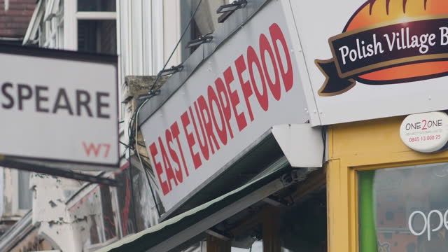 exterior shots of an east europe food shop sign on 21st march 2021 in hanwell, west london, united kingdom. - eastern european culture stock videos & royalty-free footage