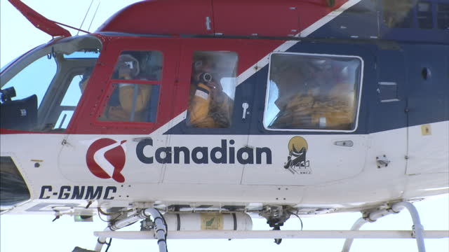 exterior shots of an expedition helicopter hovering over arctic ice floe. on august 25, 2007 in cambridge bay, canada. - icecap stock videos & royalty-free footage