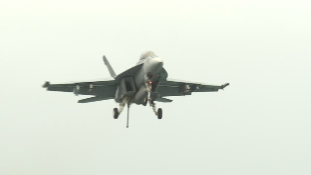 exterior shots of an f-18 hornet landing on the flight deck of the uss abraham lincoln aircraft carrier on 12 august 2019 in the arabian gulf, bahrain - us military stock videos & royalty-free footage
