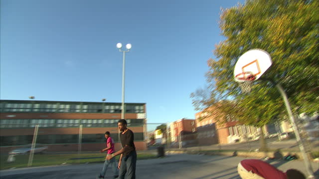 exterior shots of an inner city basketball game in progress with the camera following the action in the game on november 02 2015 in baltimore maryland - sports round stock videos & royalty-free footage