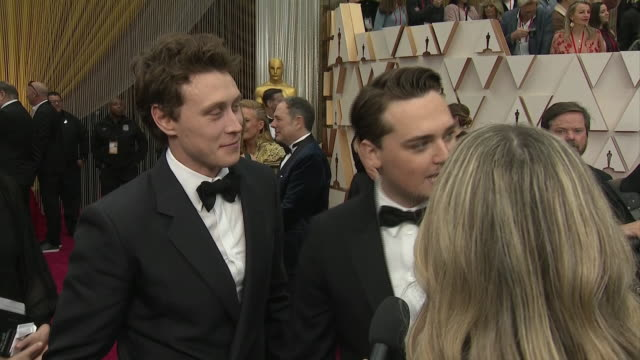 stockvideo's en b-roll-footage met exterior shots of an interview with actors george mackay and deancharles chapman at the 92nd academy awards on 9 february 2020 at the dolby theatre... - george mackay