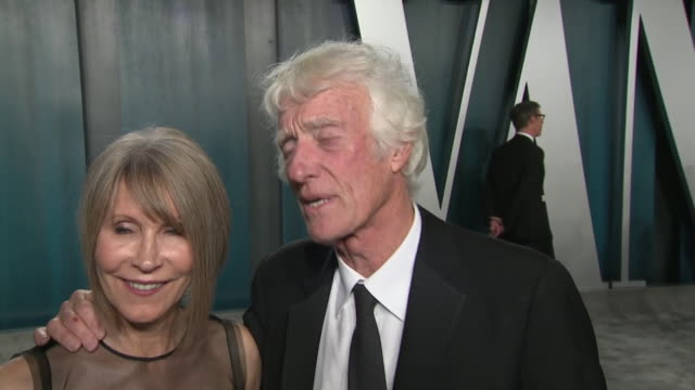 exterior shots of an interview with oscar winner cinematographer roger deakins and wife isabella james purefoy ellis at the 26th annual vanity fair... - oscar party stock videos & royalty-free footage