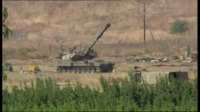 Exterior shots of an Israeli tank firing shells across the Lebanese border in the 2006 conflict between Israel and Hizbollah on July 22 2006 in...