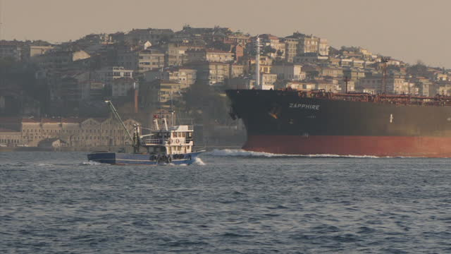 exterior shots of an oil tanker passing through the bosphorus strait, with the istanbul skyline in the background on april 14, 2017 in istanbul,... - bosphorus stock videos & royalty-free footage