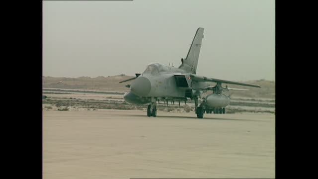 exterior shots of an raf tornado gr1 as it taxis at dhahran airbase on the first day of operation desert storm on 17 january 1991 in dhahran, saudi... - raf stock videos & royalty-free footage