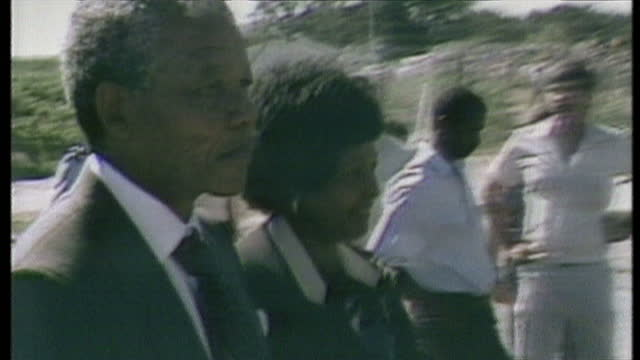 exterior shots of anc leader nelson mandels winnie mandela wife depart victor verster prison following nelson mandela's release from 27 years in... - prison release stock videos & royalty-free footage