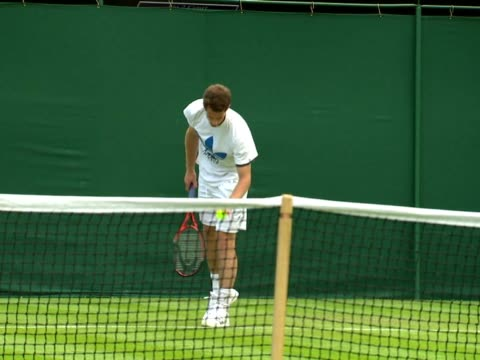 exterior shots of andy murray warming up and practising on a grass court ahead of the wimbledon tennis championships sky news at wimbledon on june 19... - championships stock videos & royalty-free footage