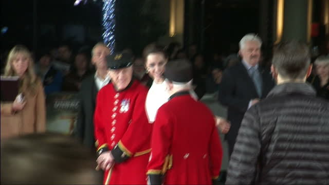 Exterior shots of Angelina Jolie posing with Chelsea Pensioners Cecil Baker and James Walter Fellows at the UK premiere of 'Unbroken'>> on November...