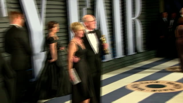 Exterior shots of animator Glen Keane posing with his Oscar for Best Animated Short Film on the red carpet at the Vanity Fair Oscars Afterparty...