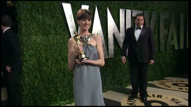 Exterior shots of Anne Hathaway posing for photos with Oscar award on red carpet of Vanity Fair Party Vanity Fair Party arrivals on February 24 2013...