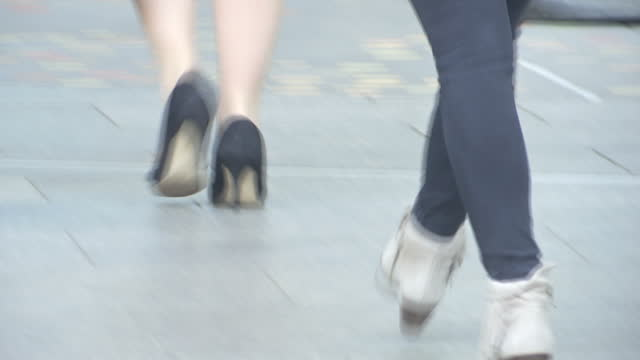 exterior shots of anonymous women walking along the pavement wearing heeled shoes high heels and office clothing in the winter on january 24 2017 in... - gender stereotypes stock videos and b-roll footage