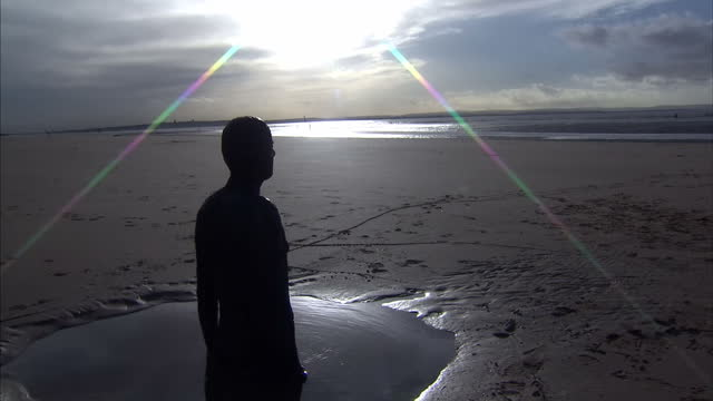 Exterior shots of Another Place artwork on Crosby Beach Cast Iron statues of Antony Gormley placed on beach facing the sea Antony Gormley's Another...
