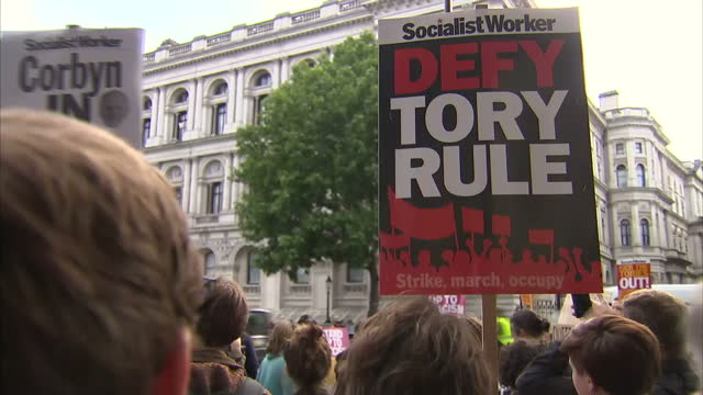 Exterior shots of anti Tory protesters with banners placards etc 'Stand up to Racism' and similar on 9 June 2017 in London United Kingdom