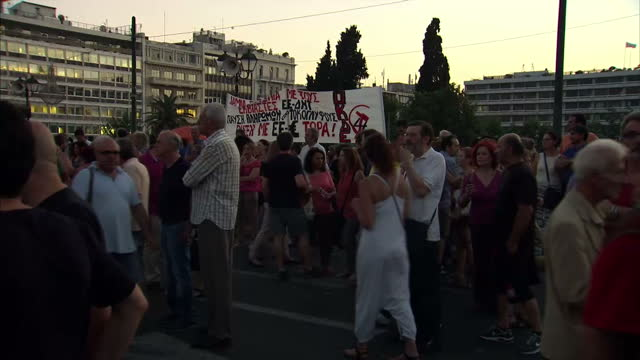 Exterior shots of antiausterity protesters demonstrating outside the Greek Parliament building as night falls>> on June 18 2015 in Athens Greece