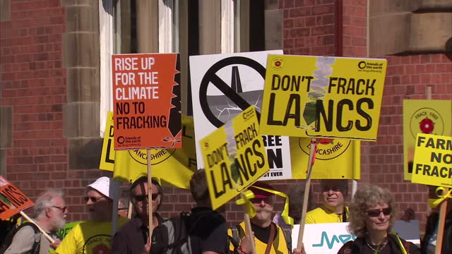 Exterior shots of antifracking protesters holding banners and placards demonstrating against the approval of fracking sites in Lancashire>> on June...
