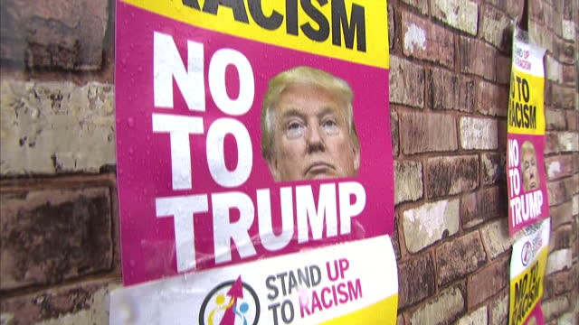 exterior shots of antiracism campaigners constructing a mock wall out of boxes near the new us embassy and attaching posters with the slogan no to... - poster wall stock videos & royalty-free footage