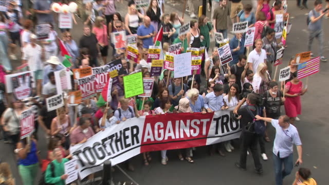 exterior shots of antitrump demonstration and protest march protesting us president donald trump's state visit to the uk on july 13 2018 in london... - state visit stock videos & royalty-free footage