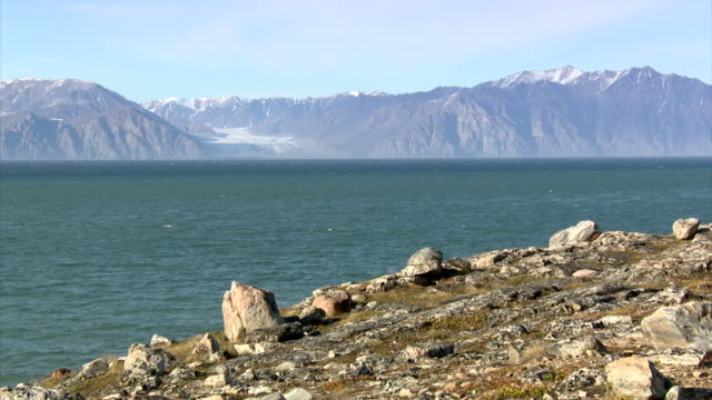 Exterior shots of arctic scenery near Pond Inlet looking across the inlet towards the uninhabited Bylot Island with its snowcovered mountains and...