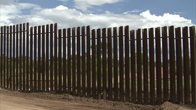 Exterior shots of Arizona's border fence with Mexico as a buzzard circles above it from the US side of the border NOTE CLIP IS MUTE on July 25 2010...