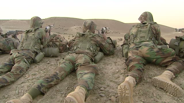 exterior shots of armed afghan national army troops training in the desert. afghan national army training on july 26, 2008 in unspecified, afghanistan - afghan national army stock videos & royalty-free footage