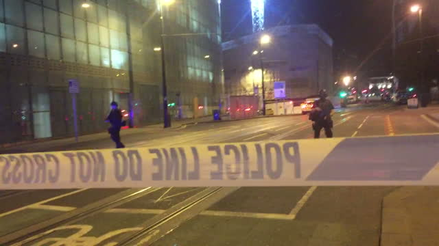 exterior shots of armed police guarding road as emergency services ambulances arrive at manchester arena after suicide bomber targets ariana grande... - manchester arena stock videos & royalty-free footage