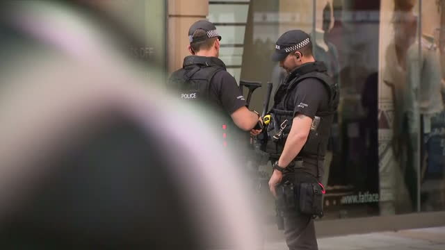 Exterior shots of armed police officers patrolling streets on 24th May 2017 Manchester England