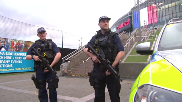 exterior shots of armed police on patrol outside wembley stadium on november 17, 2015 in london, england. - wembley stadium stock videos & royalty-free footage