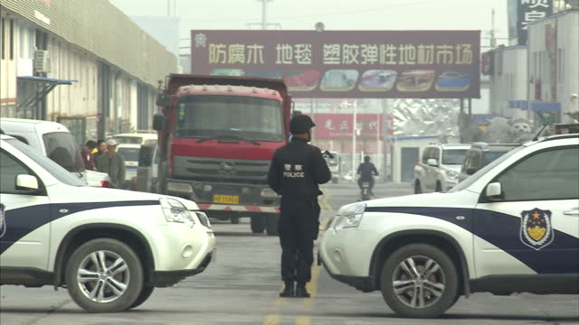 exterior shots of armed police standing guard during george osborne's visit to an industrial part of urumqi>> on september 20 2015 in urumqi china - xinjiang province stock videos & royalty-free footage
