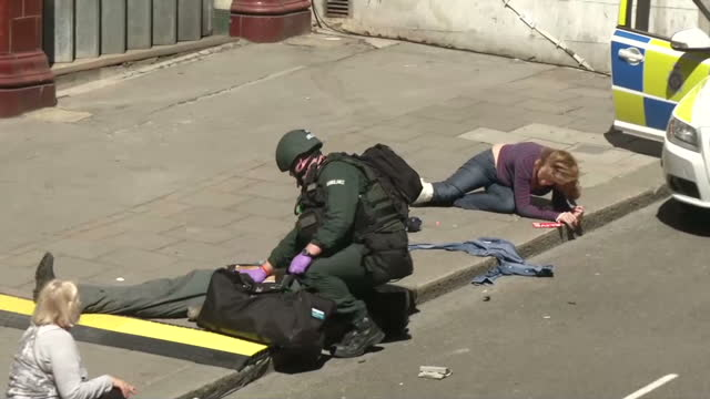 exterior shots of armed police taking part in a training exercise called operation strong tower to test their reaction and response to a terrorist... - allarme di prova video stock e b–roll
