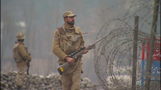 exterior shots of armed soldiers patrolling a security checkpoint area in the swat valley region located in pakistan's north west frontier province... - army stock videos & royalty-free footage