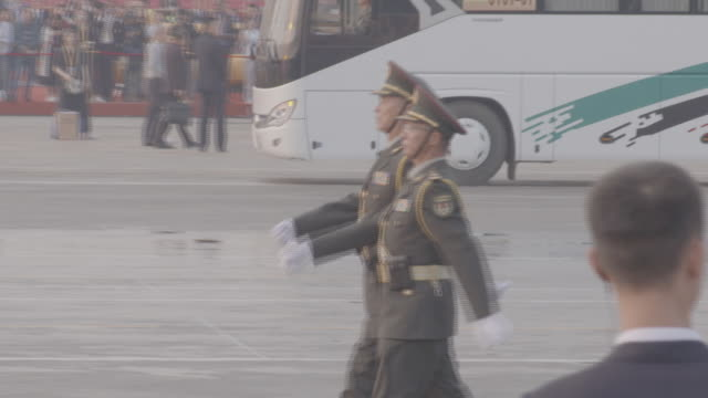exterior shots of army regiments marching in a military parade through tiananmen square, with large red balloon decoratons and 1949-2019 lettering on... - paraden stock-videos und b-roll-filmmaterial
