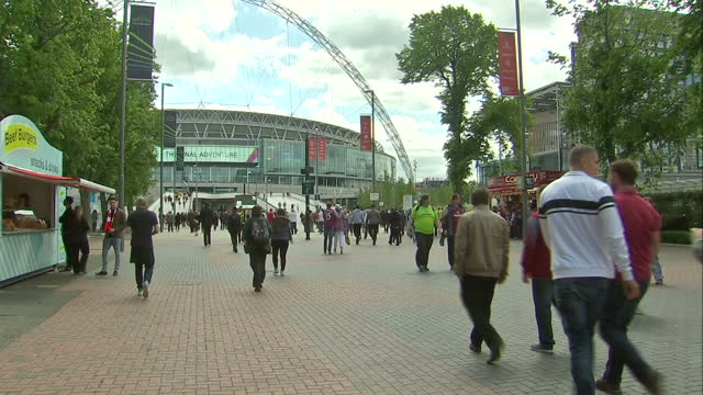Exterior shots of Arsenal and Aston Villa fans outside Wembley Stadium on May 30 2015 in London England