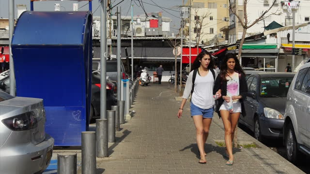 exterior shots of ashkelon streets including run down buildings graffiti and people walking along on march 17 2015 in ashkelon israel - ashkelon stock videos and b-roll footage