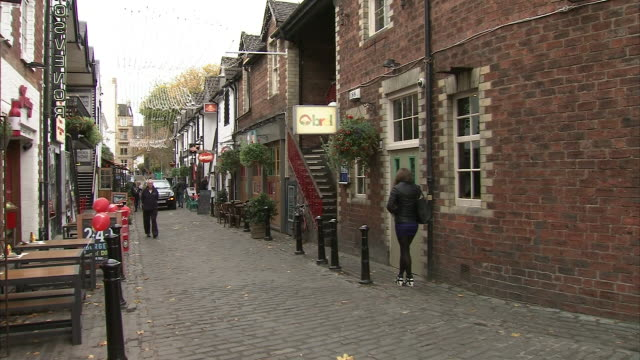 exterior shots of aston lane ashton lane a cobbled backstreet in the west end of glasgow it is connected to byres road by a short linking lane beside... - cobblestone stock videos & royalty-free footage