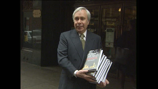 Exterior shots of author Ian Greer arriving at Harrods with copies of his book One Man's Word and giving a brief interview about being happy that his...