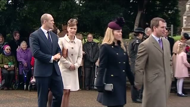 Exterior shots of Autumn and Peter Philips walking holding hands followed by Zara and Mike Tindall walking Princess Anne's children and their spouses...