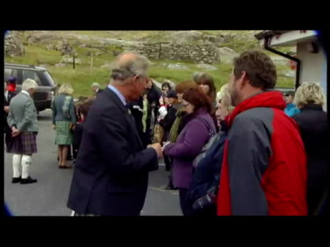 exterior shots of bagpiper playing by union flag when car arrives with duke and duchess of rothesay prince charles and camilla duchess of cornwall... - tartan stock videos & royalty-free footage