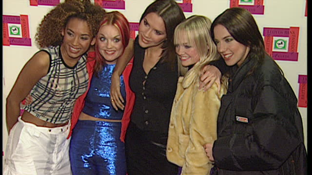 vídeos de stock e filmes b-roll de exterior shots of band members of the spice girls arriving at the albert hall and posing for photos including victoria beckham melanie brown emma... - spice girls