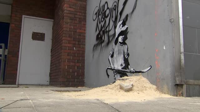 exterior shots of banksy street arts in seaside towns along the southeast coast of england on 14 august 2021 in lowestoft, united kingdom - ローストフト点の映像素材/bロール