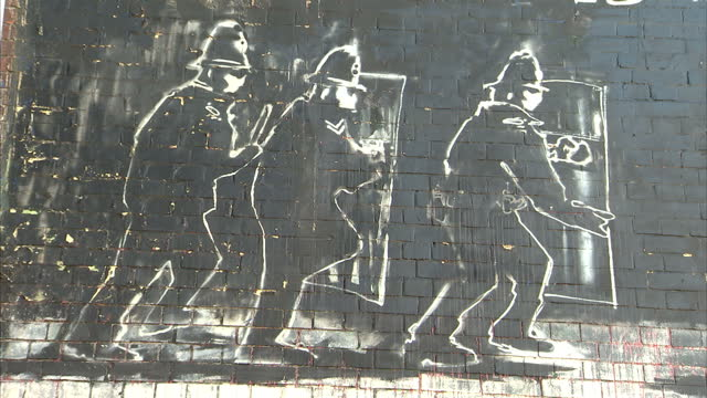 Exterior shots of Banksy's 'Mild Mild West' mural on side of building in Stokes Croft Bristol Banksy mural on side of building on October 15 2013 in...