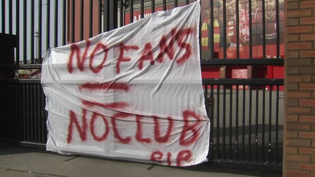 exterior shots of banners reading 'no fans no club' and 'super greed' on the gates outside anfield, in protest against the liverpool owners and the... - europe stock videos & royalty-free footage