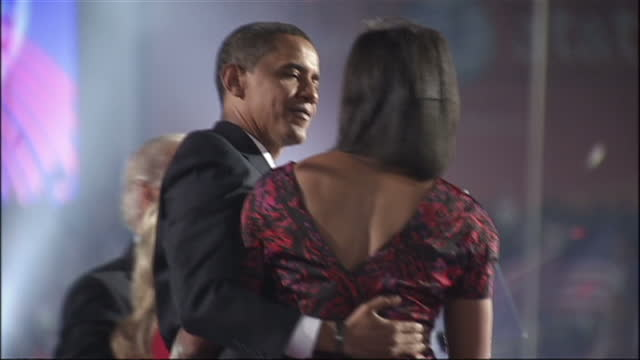 stockvideo's en b-roll-footage met exterior shots of barack obama joe biden michelle obama with daughters malia and sasha biden's wife jill jacobs and daughter ashley biden and others... - 2008