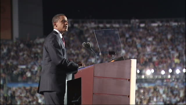 exterior shots of barack obama speaking on stage during the 2008 democratic convention at which he announced his acceptance of the democratic... - 2008 stock videos and b-roll footage