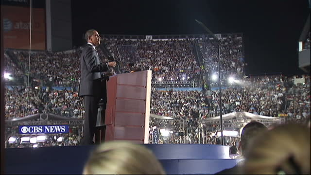 stockvideo's en b-roll-footage met exterior shots of barack obama speaking on stage during the 2008 democratic convention at which he announced his acceptance of the democratic... - 2008