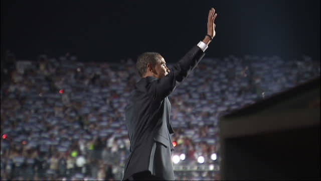 exterior shots of barack obama walking onto stage at the 2008 democratic convention in denver, colorado to cheering and applause, upon announcing his... - 2008 stock videos & royalty-free footage